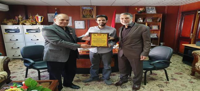 تكريم السيد الدكتور أيمن عادل عيد من جانب الملحق العسكري الكويتي